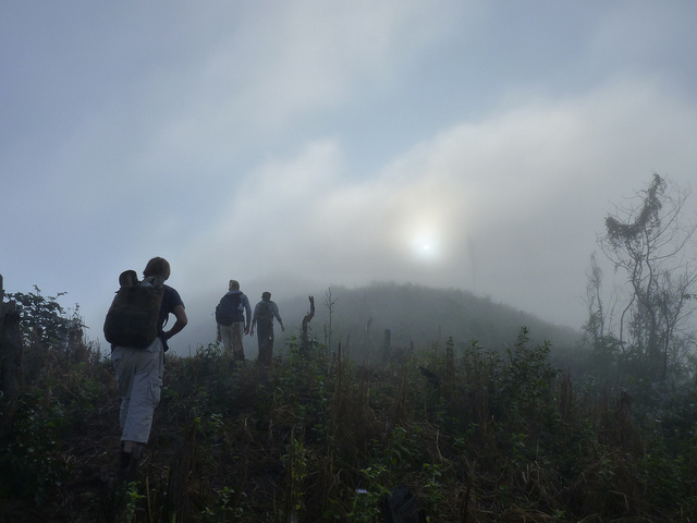 Trekking through mist to the remote village of Ahka in northern Laos.