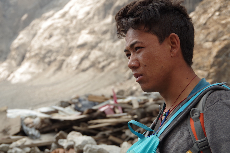 Nima's family home was levelled by the landslide. He hopes to rebuild within a year.